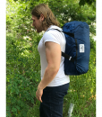 joseph wearing navy bag as backpack